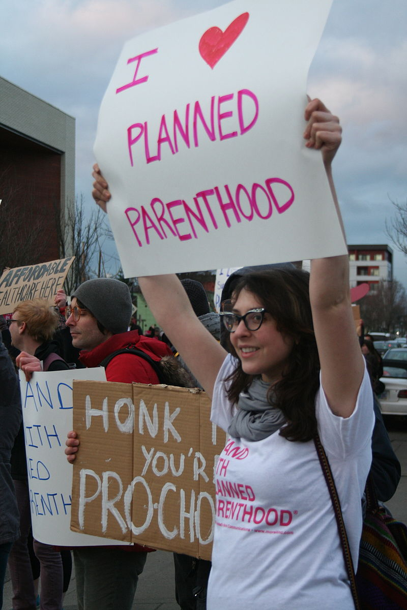 """Planned parenthood supporters"" by S. MiRK - Flickr: planned parenthood supporters. Licensed under CC BY 2.0 via Commons"